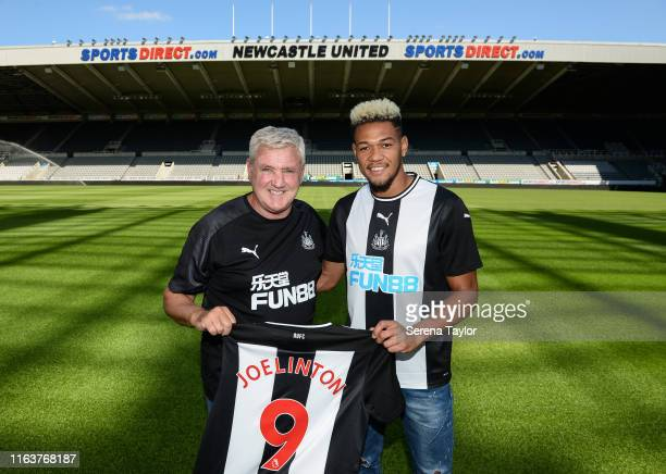 Joelinton poses for a photograph with Newcastle United Head Coach Steve Bruce during a photoshoot at StJames' Park on July 22 2019 in Newcastle upon...