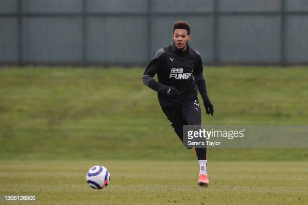Joelinton runs with the ball during the Newcastle United Training Session at the Newcastle United Training Centre on March 03, 2021 in Newcastle upon...
