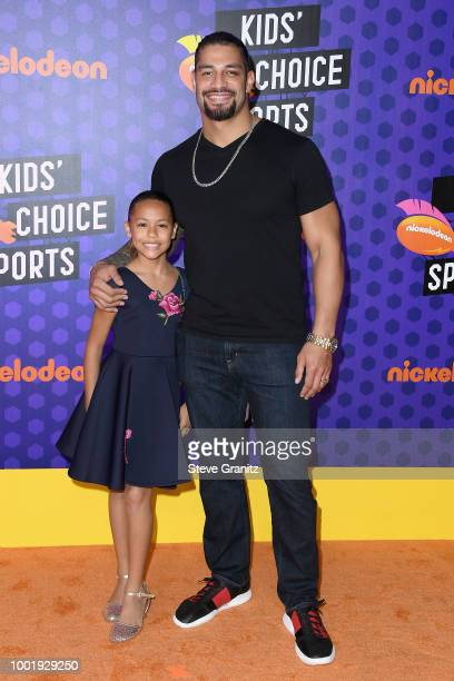 Joelle Anoa'i and WWE wrestler Roman Reigns attend the Nickelodeon Kids' Choice Sports 2018 at Barker Hangar on July 19 2018 in Santa Monica...
