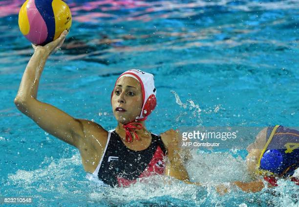 Joelle Bekhazi of Canada scores a goal against Beatriz Ortiz Munoz of Spain in 'Hajos Alfred' swimming pool of Budapest on July 26 2014 during a...