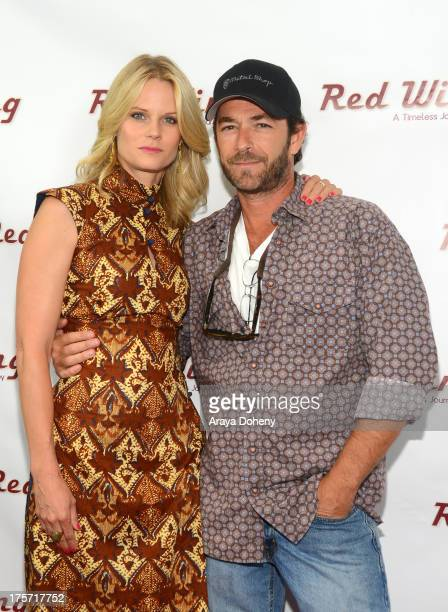 Joelle Carter and Luke Perry attend a screening of Integrity Film Production's 'Red Wing' at Harmony Gold Theatre on August 6 2013 in Los Angeles...