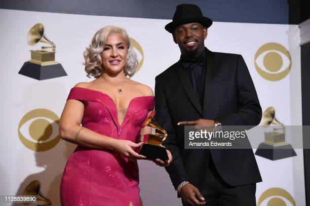 Joelle James and Larrance Dopson pose with award for Best RB Song in the press room during the 61st Annual GRAMMY Awards at Staples Center on...