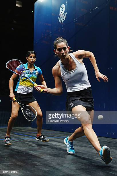 Joelle King of New Zealand competes against Joshana Chinappa of India in the Women's singles round 16 squash match at Scotstoun Sports Campus during...