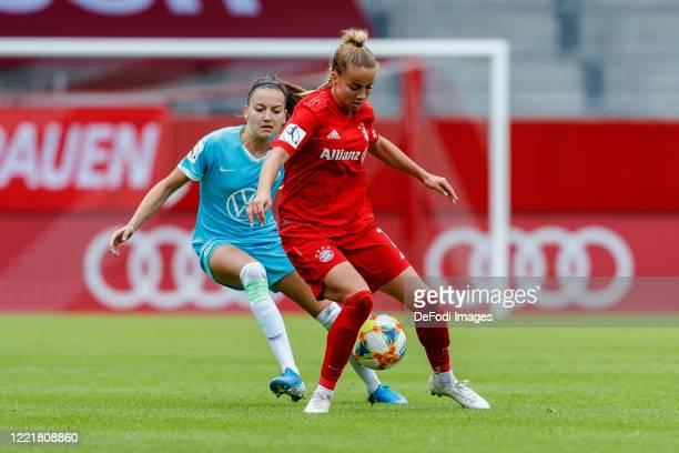 Joelle Wedemeyer of VfL Wolfsburg and Giulia Gwinn of Bayern Muenchen battle for the ball during the Flyeralarm Frauen Bundesliga match between FC...