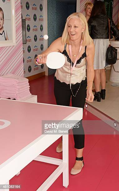 Joely Richardson plays table tennis in the evian Live Young suite on the opening day of Wimbledon at the All England Lawn Tennis and Croquet Club on...