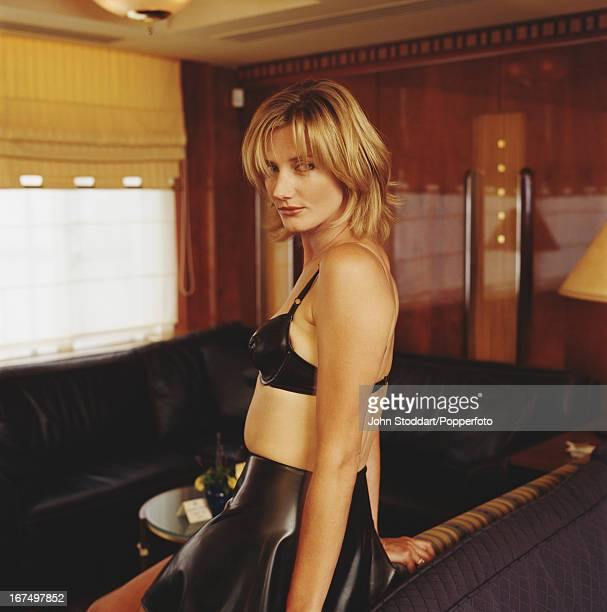 Joely Richardson wearing a PVC bra and skirt posed in 1996
