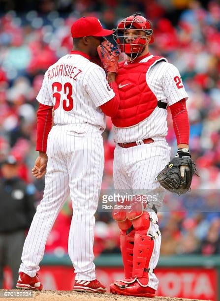 Joely Rodriguez of the Philadelphia Phillies talks with catcher Cameron Rupp during a game against the Washington Nationals at Citizens Bank Park on...