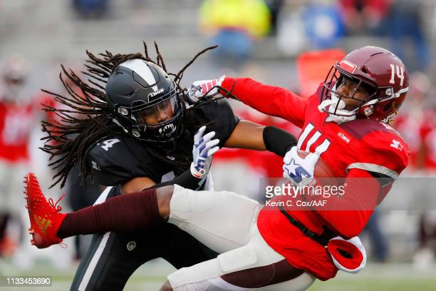 Joe Powell of the Birmingham Iron tackles De'Marcus Ayers of the San Antonio Commanders during the first half in an Alliance of American Football...