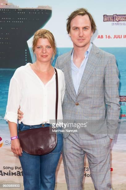 Joerdis Triebel and Lars Eidinger attend the 'Hotel Transsilvanien 3' premiere at CineStar on July 8 2018 in Berlin Germany