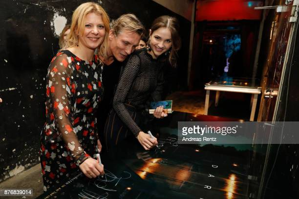 Joerdis Triebel Oliver Masucci and Lisa Vicari attend the after party to the premiere of the first German Netflix series 'Dark' on November 20 2017...
