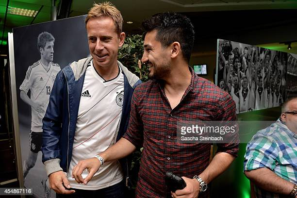 Joerg Heinrich and Ilkay Guendogan attend the 'Club Of Former National Players' meeting prior to the EURO 2016 qualifier match between Germany and...