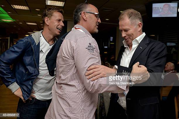 Joerg Heinrich Juergen Kohler and Stefan Reuter shake hands during the 'Club Of Former National Players' meeting prior to the EURO 2016 qualifier...