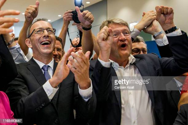 Joerg Meuthen leader of the rightwing Alternative for Germany political party and Joerg Urban main candidate of the Alternative for Germany react to...