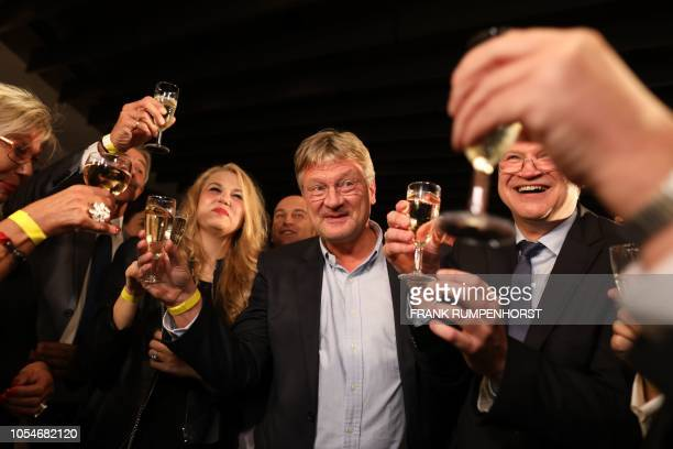 Joerg Meuthen spokesman of the Alternative fuer Deutschland party reacts as first exit polls were announced on public television during the state...