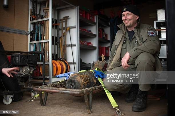 Joerg Neumann of the bomb disposal team poses next to a defused World War II bomb which was found alongside the railway line near Berlin's central...