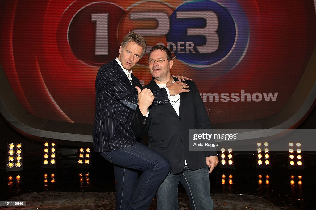 Joerg Pilawa (L) and Elton Bach attend a photocall for '1, 2 oder 3 - Die Grosse Jubilaeumsshow' at Studios Berlin Adlershof on September 1, 2012 in Berlin, Germany.