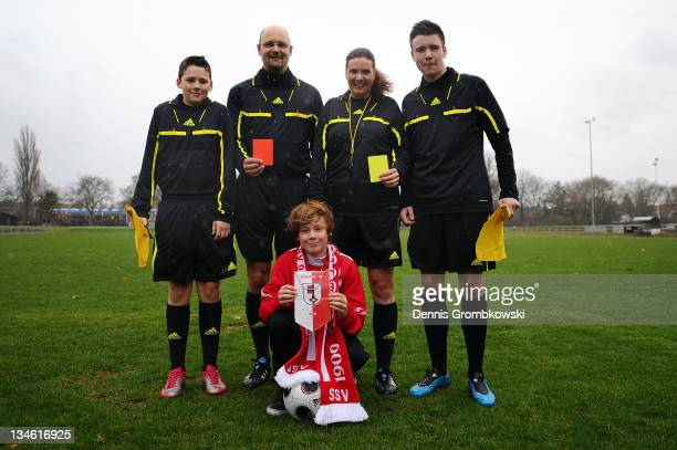 Joerg Schauer and Vincent Schauer of The Schauer family, two Generations of referees pose for a photo at Jahn-Stadion on December 3, 2011 in Soest,...