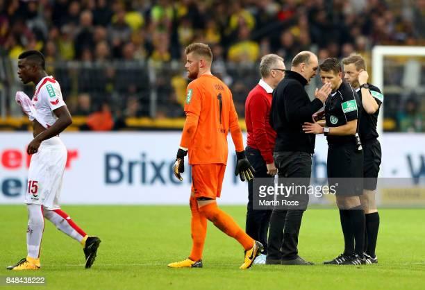 Joerg Schmadtke sport director of Koeln argues with referee Patrick Ittrich Bundesliga match between Borussia Dortmund and 1 FC Koeln at Signal Iduna...
