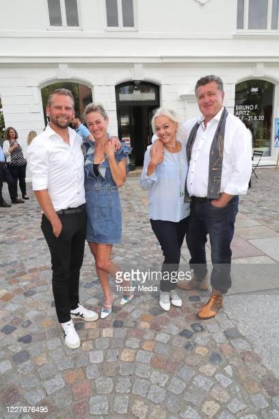 Joerg Vennewald his wife Rhea HarderVennewald and Diana Apitz and her husband Bruno F Apitz during the Bruno F Apitz exhibition opening on July 17...