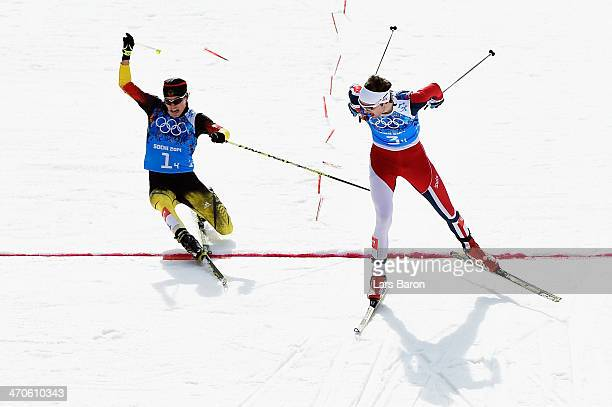 Joergen Graabak of Norway narrowly beats Fabian Riessle of Germany in the Nordic Combined Men's Team 4 x 5 km during day 13 of the Sochi 2014 Winter...