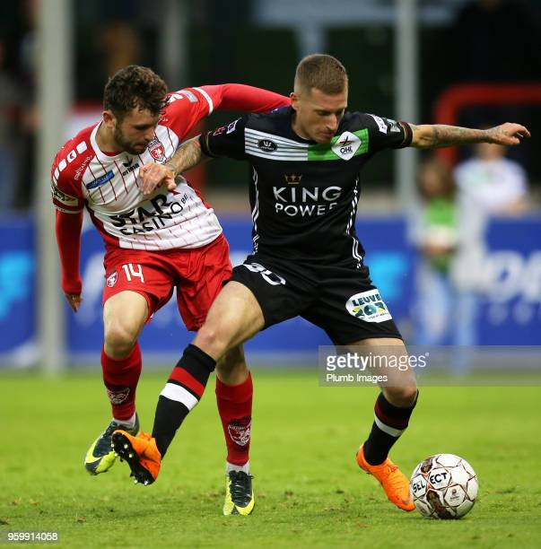 Joeri Dequevy of OH Leuven in action with Sebastjan Spahiu of Royal Excel Mouscron during the Belgian Playoff 2 tie between Royal Excel Mouscron and...
