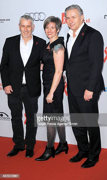 Joern Kubicki Ute Hiller and Klaus Wowereit attend the Artists Against Aids Gala 2013 at Stage Theater on November 25 2013 in Berlin Germany