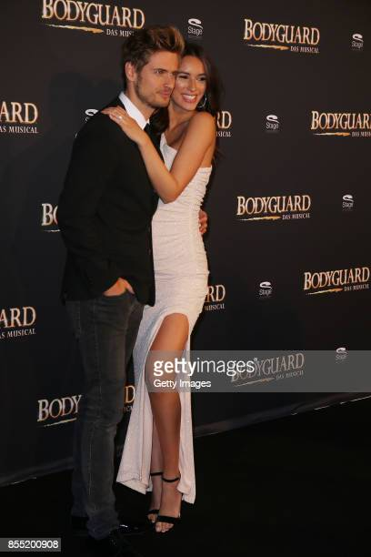 Joern Schloenvoigt and Hanna Weig attend the black carpet at the 'Bodyguard Das Musical' premiere at Stage Palladium Theater on September 28 2017 in...