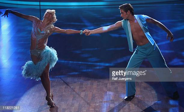 Joern Schloenvoigt and Helena Kaschurow perform during the 'Let's Dance' TV show at Coloneum on April 27 2011 in Cologne Germany