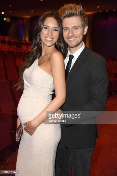 Joern Schloenvoigt and his pregnant girlfriend Hanna Weig attend the 'Bodyguard - Das Musical' premiere at Stage Palladium Theater on September 28,...