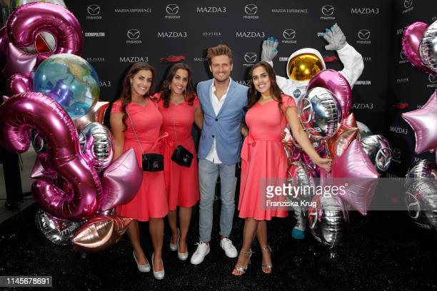 Joern Schloenvoigt and the El-Nasser triplets attend the Mazda Spring Cocktail at Sony Centre on May 23, 2019 in Berlin, Germany.