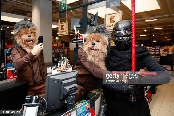 Joern Schloenvoigt Peer Kusmagk and Kylo Ren during the photo call for the new ad campaign Das gute in dir by Kaufland on November 27 2019 in Berlin...
