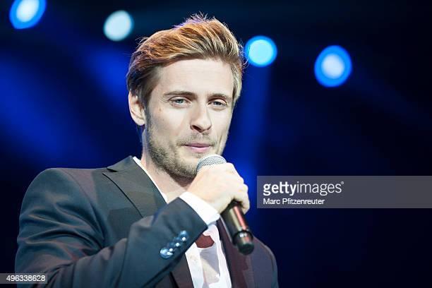 Joern Schloenvoigt performs onstage during the 'SchlagerStarparade' at the KoenigPilsenerArena on November 8 2015 in Oberhausen Germany