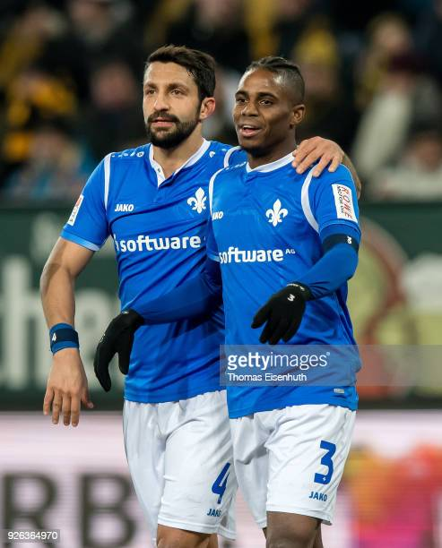 Joevin Jones of Darmstadt celebrates with his teammate Aytac Sulu after scoring his team's first goal during the Second Bundesliga match between SG...