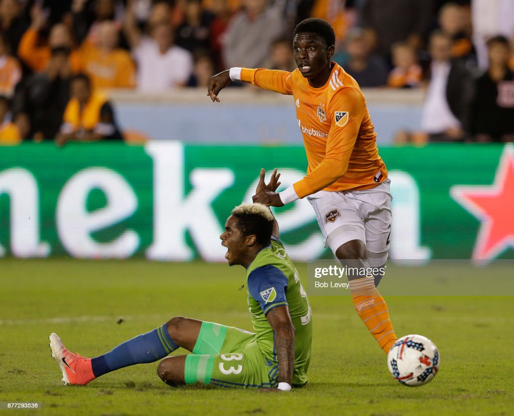 Joevin Jones #33 of Seattle Sounders is tackled in the penalty area by Jalil Anibaba #2 of Houston Dynamo in the first half at BBVA Compass Stadium on November 21, 2017 in Houston, Texas. Anibaba was issued a red card for the penalty.