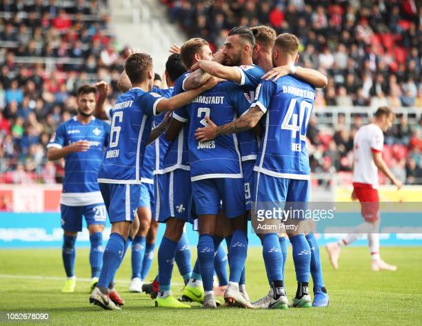 Joevin Jones of SV Darmstadt 98 is congratulated by team mates after scoring the first goal during the Second Bundesliga match between SSV Jahn...