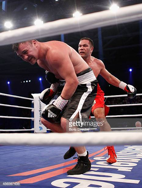 Joey Abell of United States falls after a punch from Kubrat Pulev of Bulgaria and during their IBF international heavyweight championship fight at...