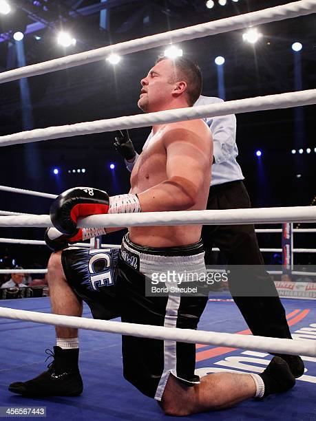 Joey Abell of United States sits in the ring after he was knocked out during his IBF international heavyweight championship fight against Kubrat...
