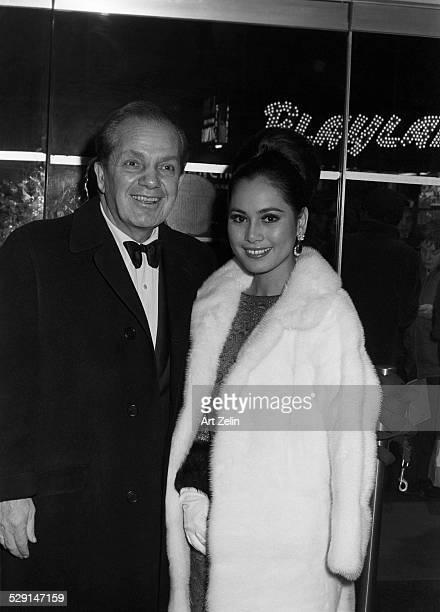 Joey Adams with Cindy Adams his wife in formal dress circa 1970 New York
