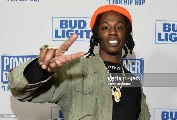 Joey Bada$$ poses during Power 106 FM's Cali Christmas at The Forum on December 16 2017 in Inglewood California