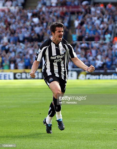 Joey Barton celebrates after scoring the opening goal during the Barclays Premier League match between Newcastle United and Aston Villa at St James'...
