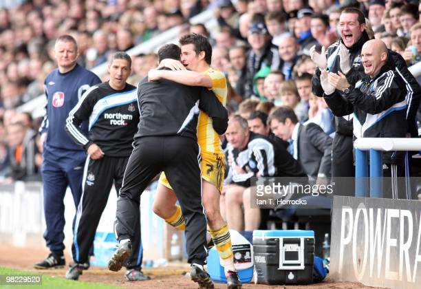 Joey Barton celebrates with the Newcastle bench after scoring Newcastle's second goal during the Coca Cola Championship match between Peterborough...
