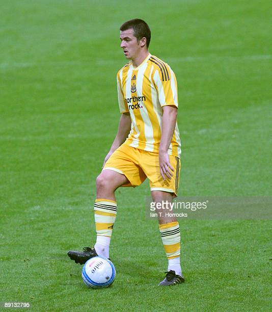 Joey Barton in action during a preseason friendly match between Huddersfield Town and Newcastle United at the Galpharm Stadium on July 21 2009 in...
