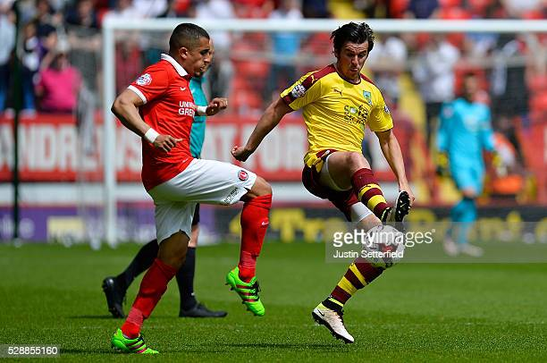 Joey Barton of Burnley and Ahmed Kashi of Charlton Athletic compete for the ball during the Sky Bet Championship match between Charlton Athletic and...