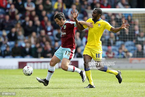 Joey Barton of Burnley battles with Mustapha Carayol of Leeds during the Sky Bet Championship match between Burnley and Leeds United at Turf Moor on...