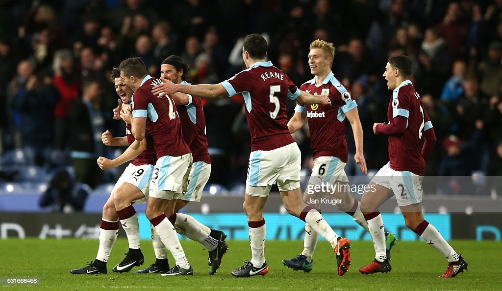 Joey Barton of Burnley (L) celebrates scoring his sides first goal during the Premier League match between Burnley and Southampton at Turf Moor on January 14, 2017 in Burnley, England.