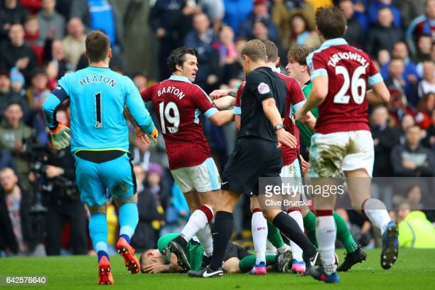 Joey Barton of Burnley clashes with the Lincoln City players during The Emirates FA Cup Fifth Round match between Burnley and Lincoln City at Turf...
