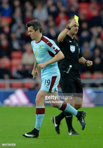 Joey Barton of Burnley is shown a yellow card by referee Robert Madley during the Premier League match between Sunderland and Burnley at Stadium of...