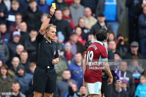 Joey Barton of Burnley is shown the yellow card by referee Graham Scott during The Emirates FA Cup Fifth Round match between Burnley and Lincoln City...