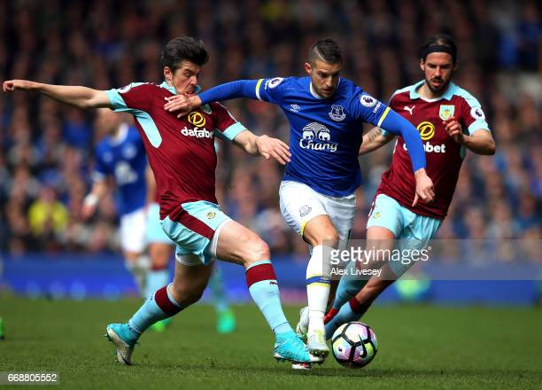 Joey Barton of Burnley tackles Kevin Mirallas of Everton during the Premier League match between Everton and Burnley at Goodison Park on April 15...