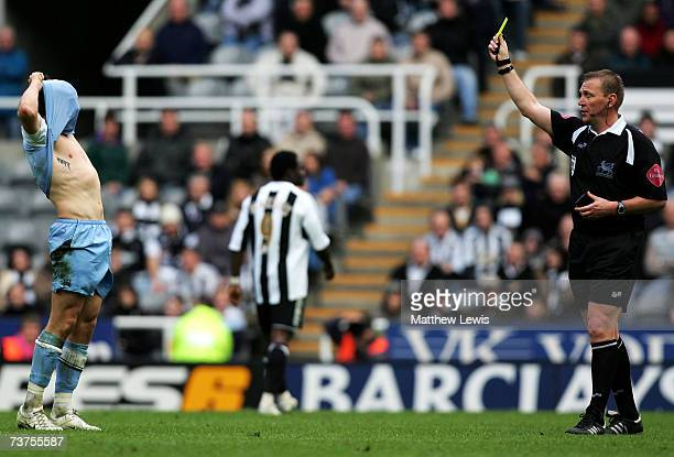 Joey Barton of Manchester City is booked by Referee Graham Poll during the Barclays Premiership match between Newcastle United and Manchester City at...